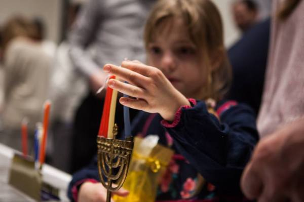 preparing the hanukkiah